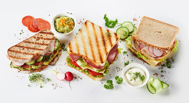 Trio of gourmet sandwiches on assorted bread