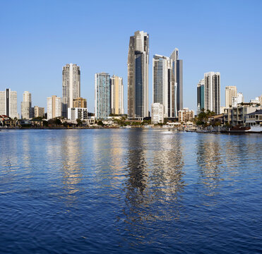 View across calm water looking at residential homes and high rise apartment blocks of Surfers Paradise taken from Bundle on the Gold Coast