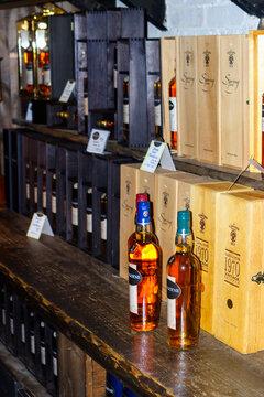 Single malt Whisky bottles at a shelf in a store