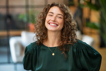 Fototapeta Satisfied business woman laughing at office