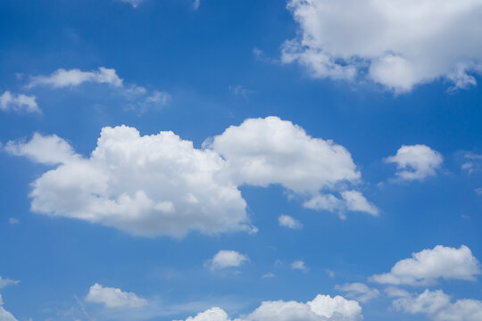 Beautiful white fluffy clouds on vivid blue sky in a suny day