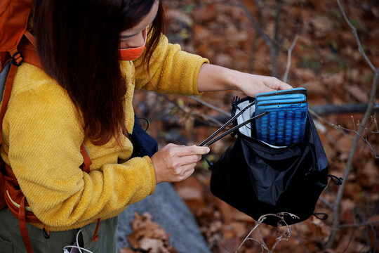 Kim Kang-Eun, an artist who leads Clean Hikers, collects a litter while hiking a mountain in Incheon, South Korea