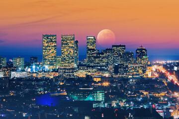 Fotobehang - Ful moon rising over Los Angeles skyline at night