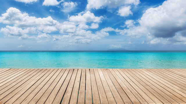 Tropical Sunny beach with wooden floor and the turquoise sea on Paradise island.