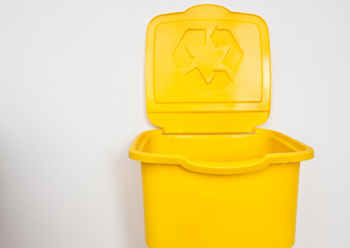 One yellow trash can for sorting garbage. For plastic or glass or paper