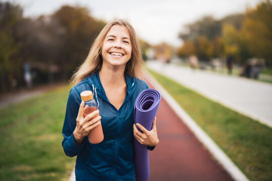 Beautiful adult woman is ready for outdoor exercising on cloudy day in autumn.