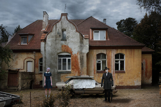 Mystical picture of an old house with strange persons