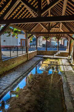 Bernay city Historic traditional washhouse alongside river in Normandy, France