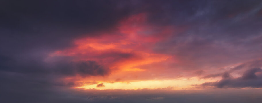 background of cloudscape at dusk with red clouds on sky