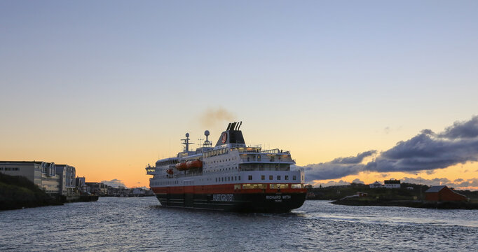 Coastal liner MS Richard with  arrives in Bronnoysund harbor Nordland county in Northern Norway at sunset