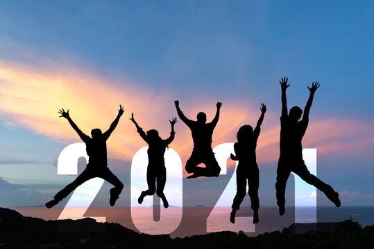 Silhouette happy business teamwork jumping congratulation and celebrate in Happy New year 2021 for change new life future concept. Freedom lifestyle group people team jump as part of Number 2021