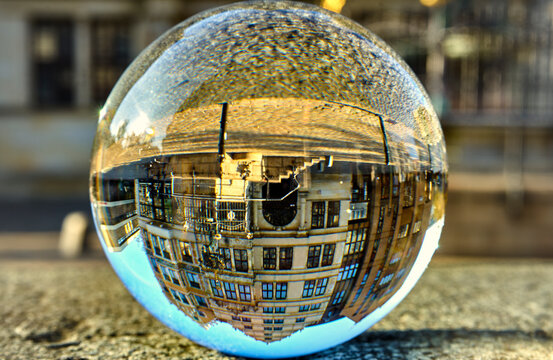 Crystal ball with upside down historical buildings in the old town