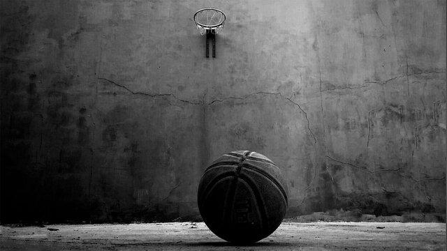 Basketball On Floor With Hoop Hanging On Wall