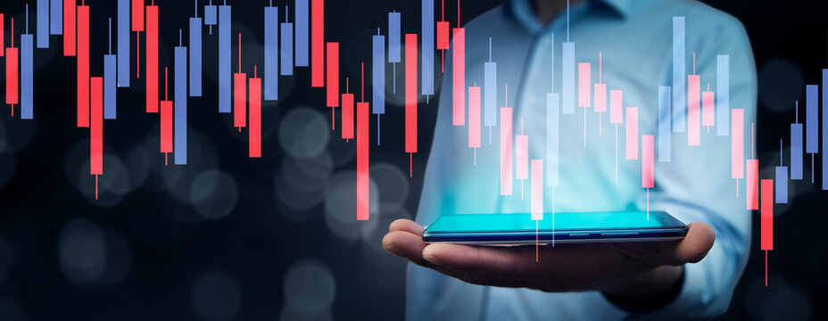 Businessman trading stocks using tablet