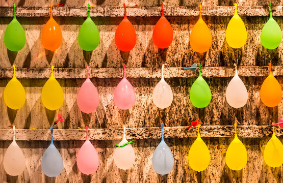 Full Frame Shot Of Multi Colored Balloons Hanging On Wall