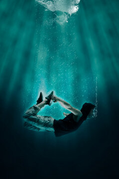 Man is drowning under water