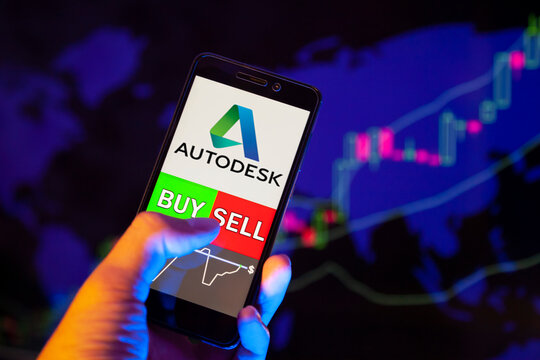 Company logo Autodesk, Inc. (ADSK) on smartphone screen, hand of trader holding mobile phone showing BUY or SELL on background of stock chart. Russia, Stavropol - May 29, 2019