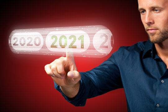 man is using virtual interface to select 2021 on red background