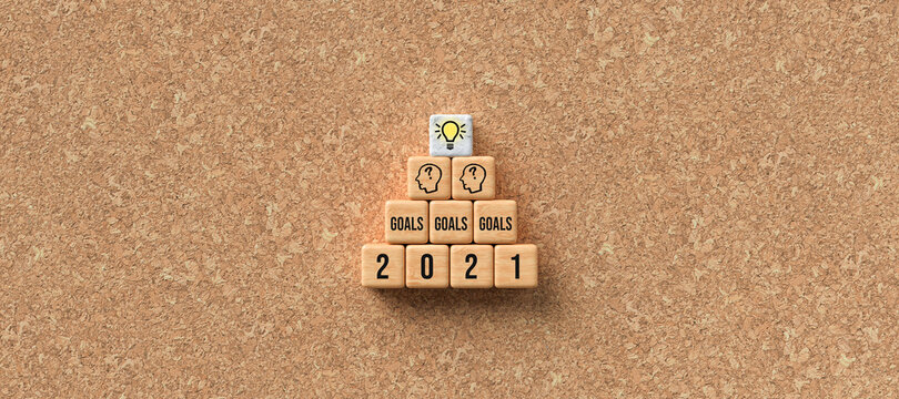 message GOALS 2021 on wooden cubes on cork background