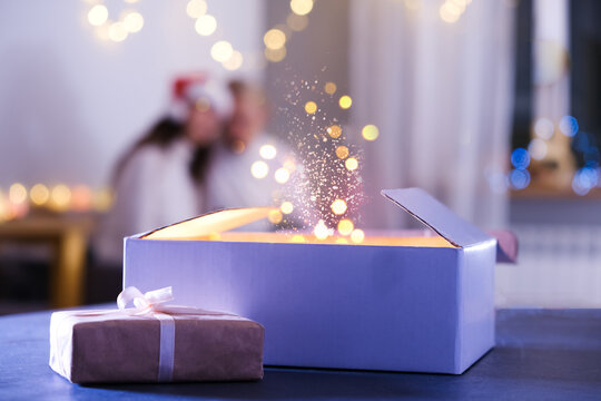 Hands opens gift, miracles and wishes come true, Christmas