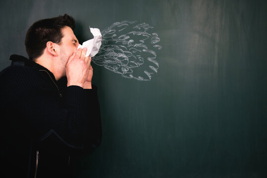 Mid Adult Man With Chalk Drawing On Blackboard
