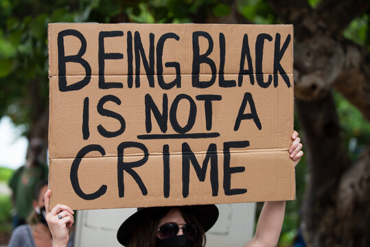 Miami, FL, USA - JUNE, 2020: Being black is not a crime poster. Black Lives Matter.