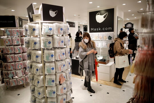 Shoppers are seen at the face mask speciality shop Mask.com, amid the coronavirus disease (COVID-19) outbreak, in Tokyo