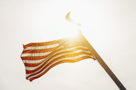 Low Angle View Of American Flag Against Clear Sky