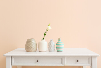 Beautiful vases with flower on light table