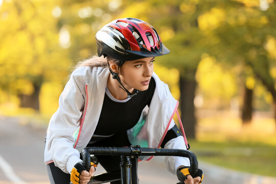 Female cyclist riding bicycle outdoors
