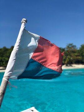 Close-up Of Flag Against Sea