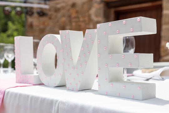 Romantic love decoration on a cozy wedding table