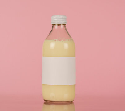 Small glass bottle with plant milk