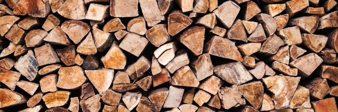 Stack of wood logs, wooden abstract panoramic fall and winter background