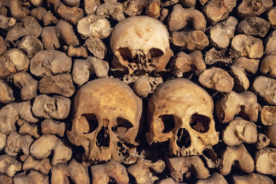 Stack of skulls and bones in the catacombs of Paris, France