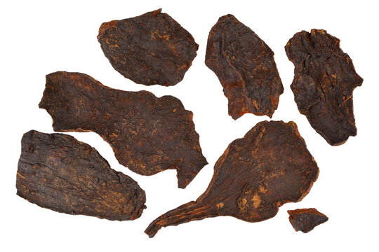 He Shou Wu Fo-Ti Dry Root (Polygonum Multiflorum). Black Bean Cured All Purpose Herb. Isolated on White.