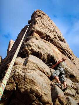 woman with safety rope at sport climbing