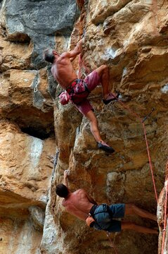 man with safety rope at sport climbing