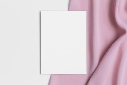 White invitation card mockup with a soft pink textile. 5x7 ratio, similar to A6, A5.
