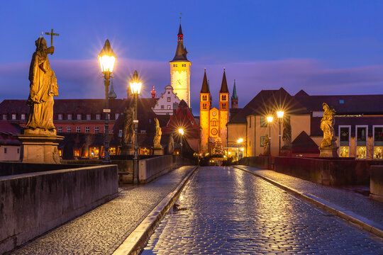 Old Main Bridge, Alte Mainbrucke with statues of saints, Cathedral and City Hall in Old Town of Wurzburg at sunset, Franconia, Bavaria, Germany
