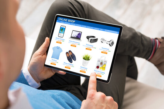 Man shopping at online store on his tablet computer