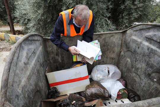 Mohammad Salem Abu Zakrya collects copies of the Koran and other books that are abandoned to fix them, in Jerash