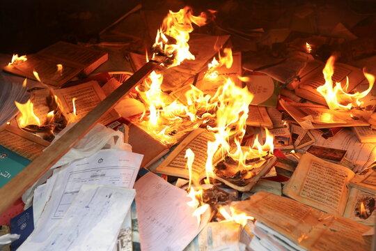 Mohammad Salem Abu Zakrya burn books that he cannot fix, in Jerash
