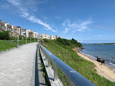 Vladivostok, Russia,  July, 13, 2020. Promenade in Patroclus (Patrokl) bay in summer in sunny day. Vladivostok, Russia