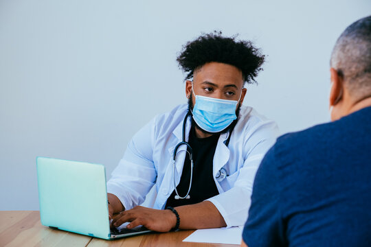 Portrait of doctor and patient with face masks during medical exam and consultation,