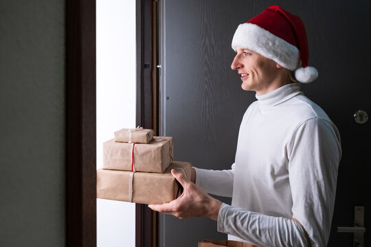 Christmas, New Year delivery, man courier in Santa hat, mask