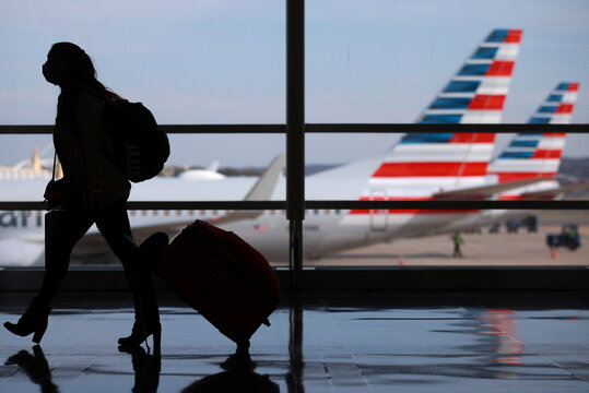 A person walks at Reagan National Airport ahead of the Thanksgiving holiday in Arlington