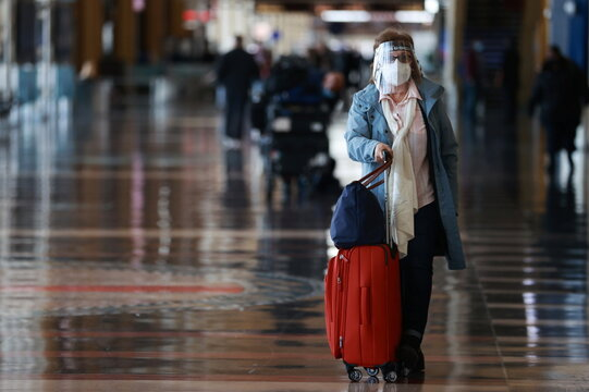 A woman walks at Reagan National Airport ahead of the Thanksgiving holiday in Arlington