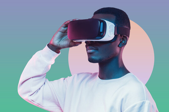 Retro futuristic portrait of young african american man wearing virtual reality VR headset