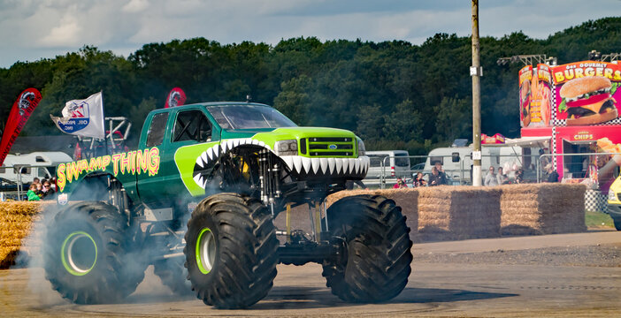 Podington, Bedfordshire, UK – August 18 2019. An illustrative photo of the monster truck Swamp Thing smoking its tires during a public demonstration.